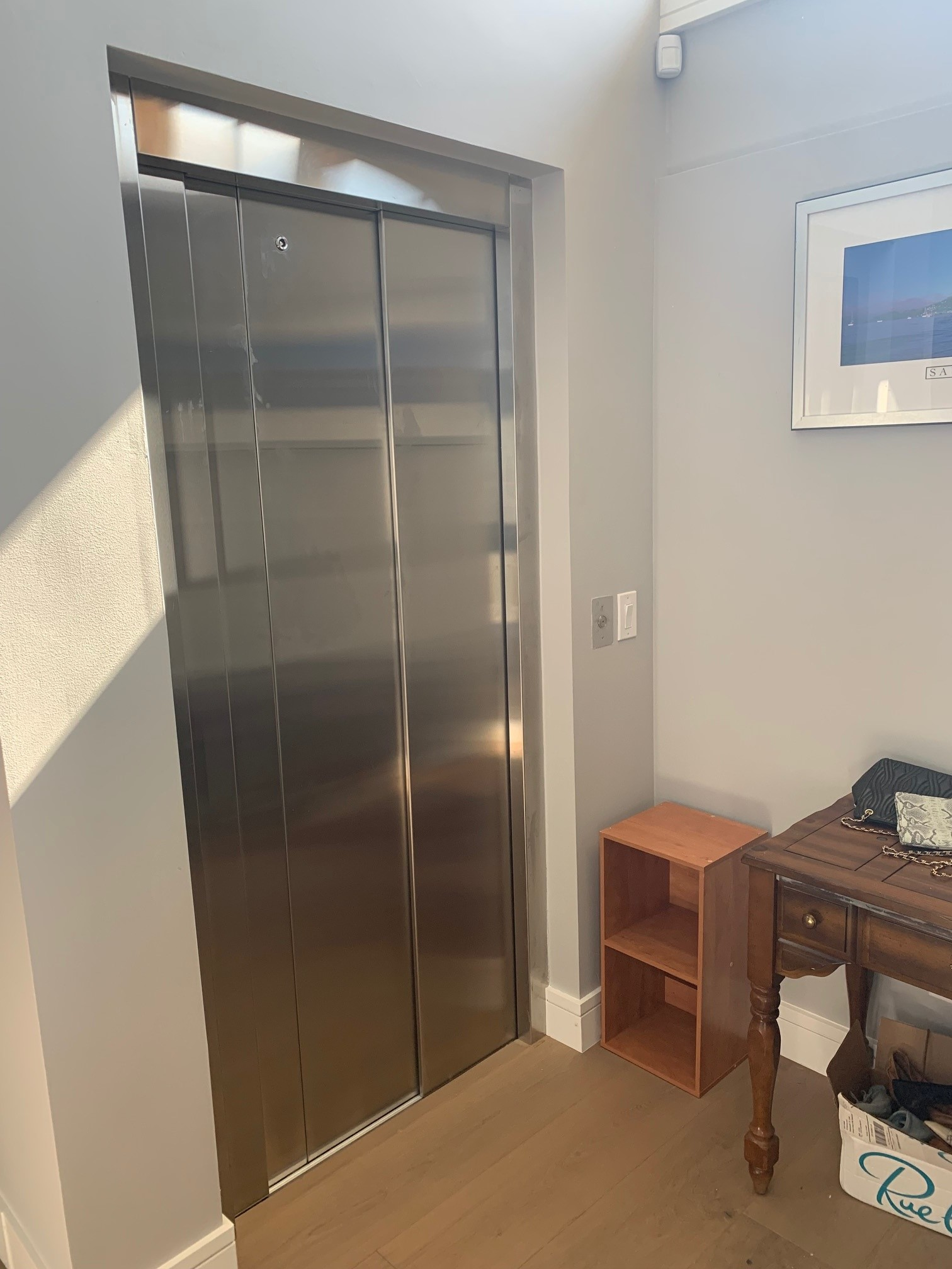 Savaria Eclipse with Stainless Steel Slim-Line Doors Showcased In-Home