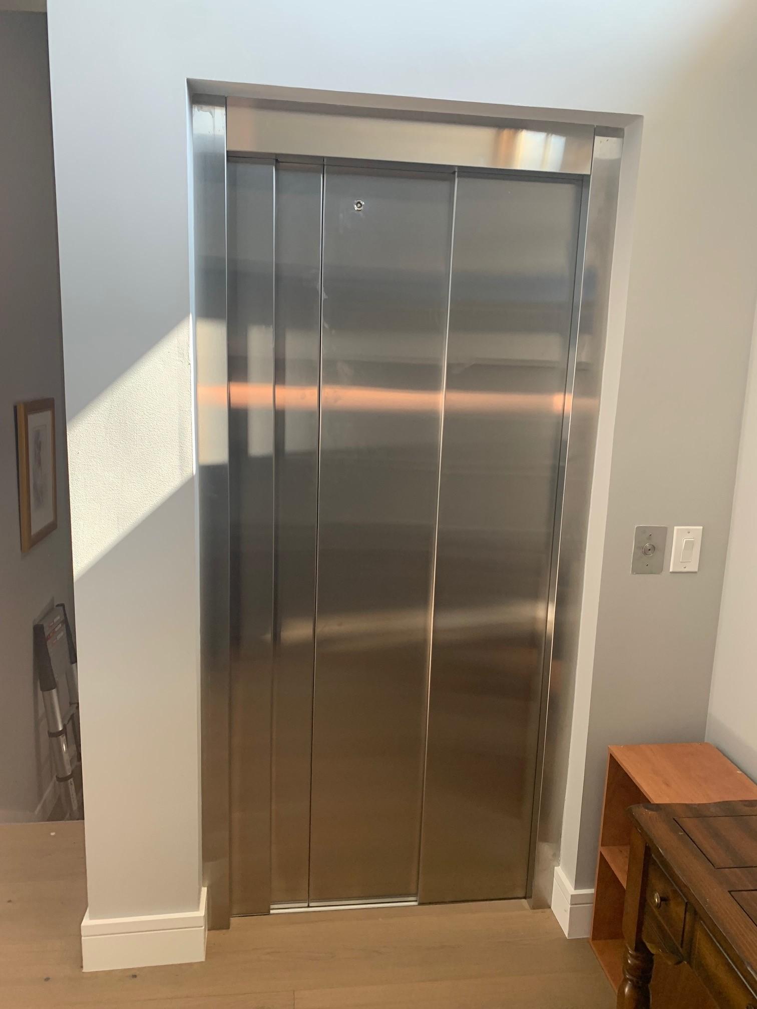 Savaria Eclipse with Stainless Steel Slim-Line Doors