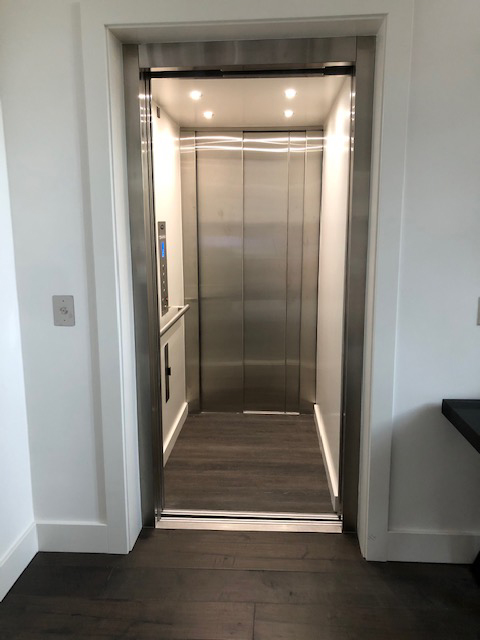 LULA Commercial Elevator with Interior Stainless Steel Doors Closed