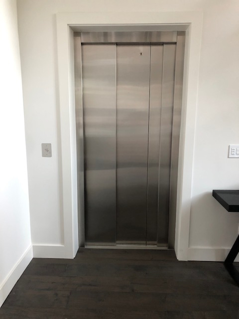 LULA Commercial Elevator - Stainless Steel Doors Closed